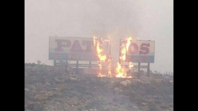 Firestorm burns down into Pateros