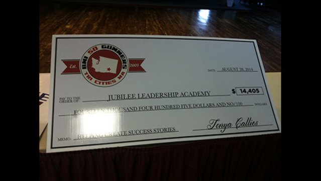 The Tri Cities BNI Gunners Chapter Presents Check to Jubilee Leadership Academy