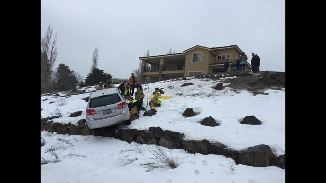 Ice causes car to slide, traps Richland boy