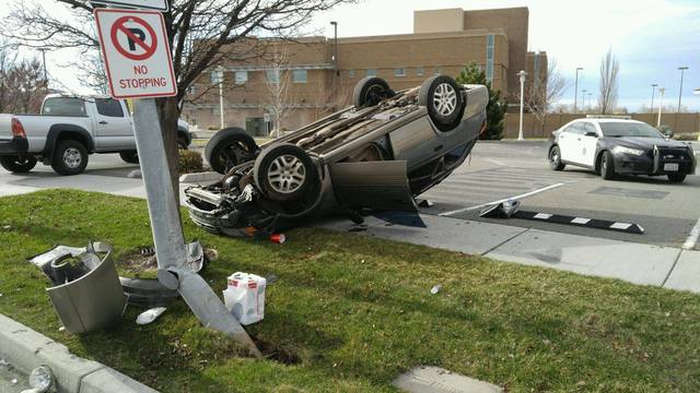 Woman flips car using cell phone while driving